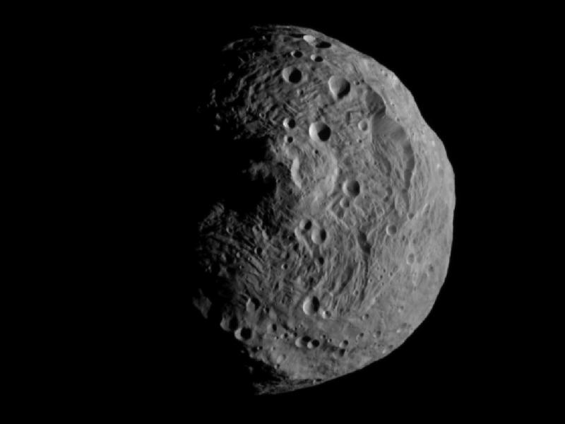 [Asteroid Vesta � image obtained by NASA's Dawn spacecraft (http://www.nasa.gov/mission_pages/dawn/main/index.html). Vesta is one of the largest asteroids in the solar system with a diameter of about 328 miles (525 km). Image credit: NASA/JPL-Caltech/UCLA/MPS/DLR/IDA.  From http://www.nasa.gov/mission_pages/dawn/multimedia/pia14313.html]
